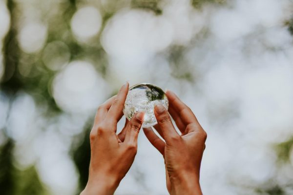 Womans hands holding a crystal ball